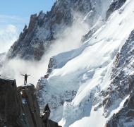 Climber tops out on the Cosmique Arete