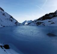 Frozen Loch Coimín Uachtarach nestled high beneath Corrán Tuathail