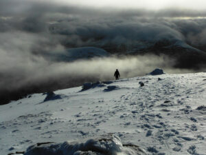 Winters evening light as a climber descends towards the Devil's Ladder